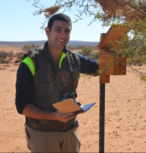 Andrew checking nest-boxes in the outback